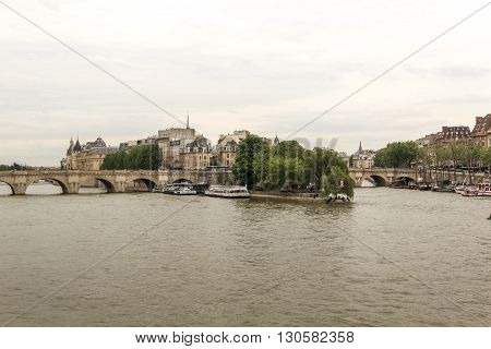 Paris, France - May 14: This is view of the historical center of Paris island Cite from the Seine river May 14, 2013 in Paris, France.