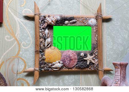 beautiful photo frame adorned with seashells hromakey