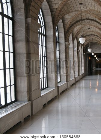 Windowed hallway with magnificent architecture and accessories
