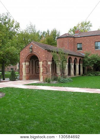 Beautiful walkway to brick building with grass