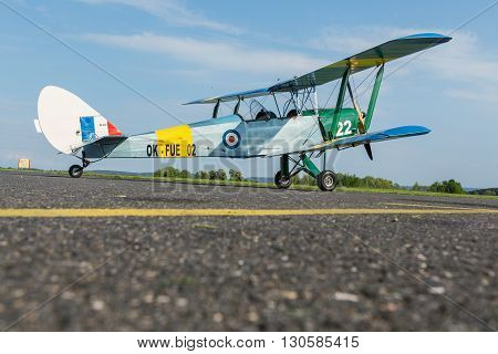Pribram CZE - MAY 20 2016: DH 82c TIGER MONTH - replica biplane on runway at airport Pribram MAY 20 2016: