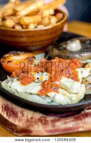 Grilled halloumi with tomatoes served with chips