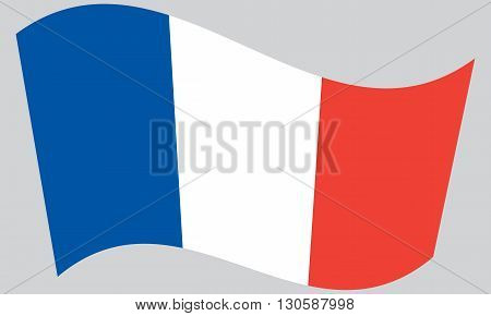 Flag of France waving on gray background