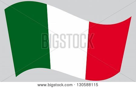 Flag of Italy waving on gray background