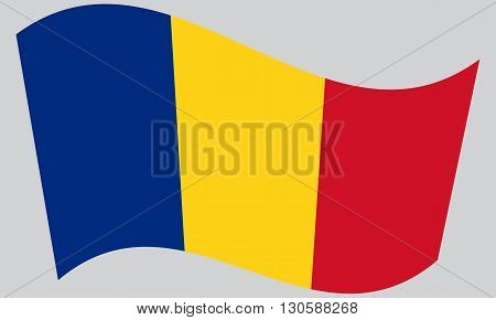 Flag of Romania waving on gray background