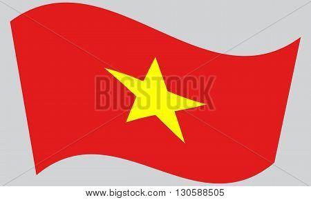 Flag of Vietnam waving on gray background