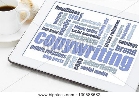 copywriting word cloud in blue and white on a digital tablet with a cup of coffee