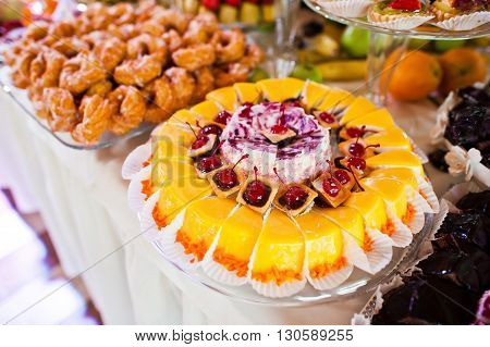 Elegance Wedding Reception Table With Food And Decor. Baking Cherry Cake