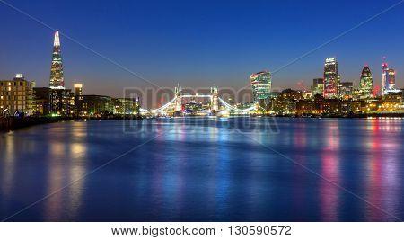 Tower Bridge and cityscape of London at night, UK