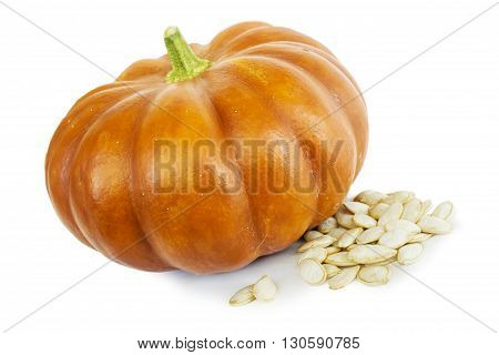 Pumpkin with a bright peel and seeds on white
