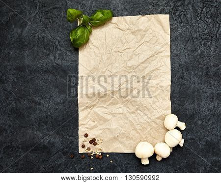 Cooking Healthy Eating Vegetarian concept. Basil and mushrooms with spices on dark background. Top virw copy space