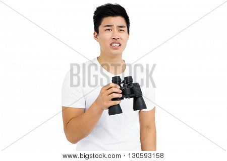 Young man holding binoculars on white background