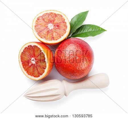 Fresh ripe red oranges and juicer. Isolated on white background. Top view
