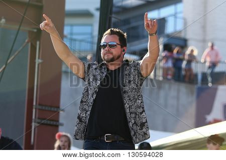 FRISCO, TX-APR 23: Singer Mike Eli of the Eli Young Band performs onstage during the 2016 Off The Rails Music Festival - Day 1 at Toyota Stadium in Frisco, Texas