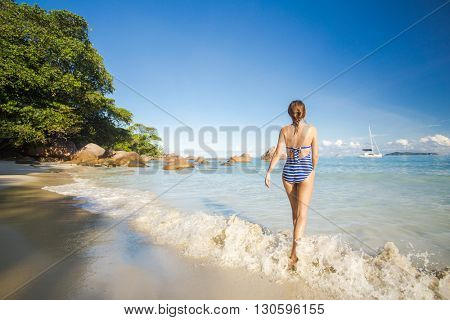 Beautiful woman enjoying the beautiful beachs of Praslin, Seychelles