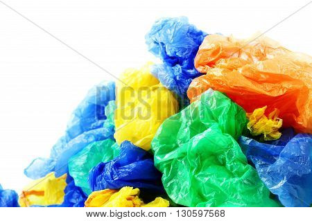 Colorful plastic garbage bags on a white background