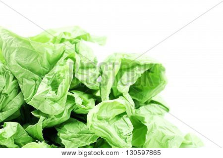 Green plastic garbage bags on a white background