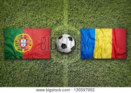 Portugal Vs. Romania Flags On Soccer Field