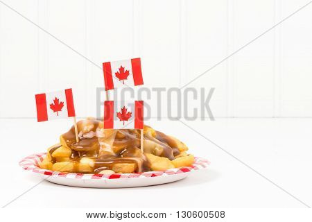 A plate of poutine a unique dish that originated from the province of Quebec.