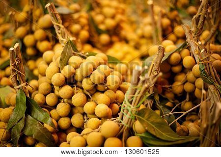 Fresh longan fruits. Traditional thai market close up.