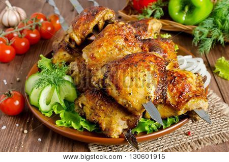 Grilled of chicken thighs on skewers with vegetables