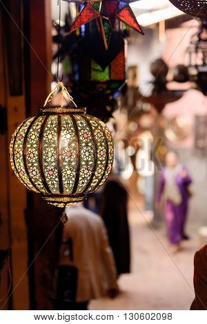 A traditional lamp on sale at a market stall in souks of Marrakech Morocco.