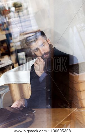 Young Hipster Businessman On Break For A Coffee