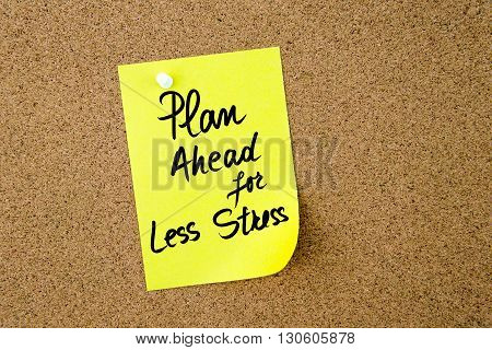 Plan Ahead For Less Stress Written On Yellow Paper Note