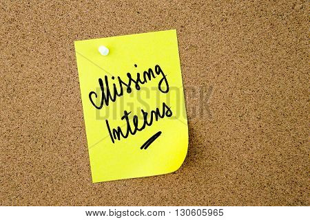 Missing Interns Written On Yellow Paper Note