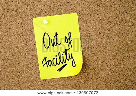 Out Of Facility Written On Yellow Paper Note