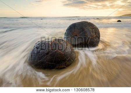 Sunrise over Moeraki boulders, South of New Zealand