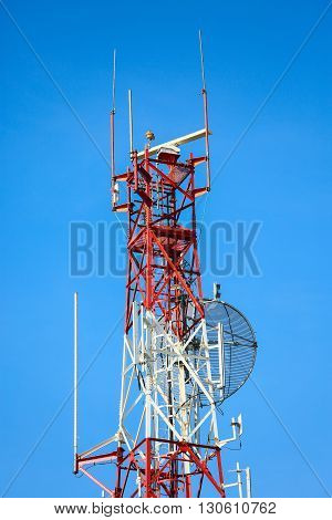 Telecom tower install communication equipment for sent signal to the city, Satellite dish telecom network in the city, industry communication.