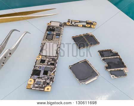 Repairing Smart Phone on Desk Selective Focus