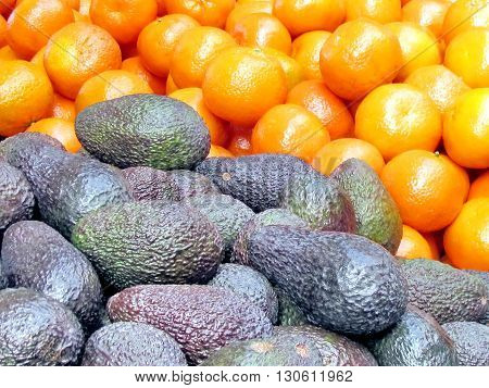 Avocado and tangerines on Bazaar Shuk Carmel in Tel Aviv Israel