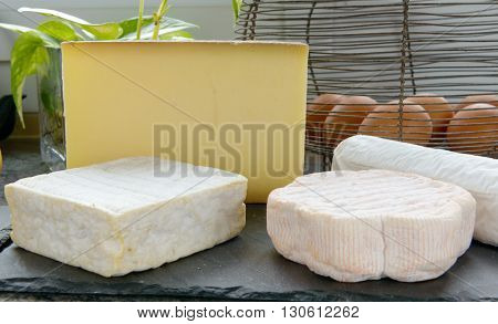 a tray with different French cheeses with eggs