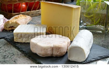 a tray with the  different French cheeses