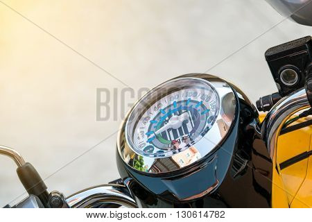 Closeup at the speedometer of a motorcycle.