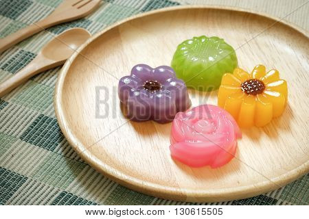 Layer Sweet Cake or Kanom Chan flowers on wooden plates Thai dessert.