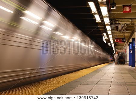 New York City, New York, USA - April 17, 2016: New York subway with fast moving train.