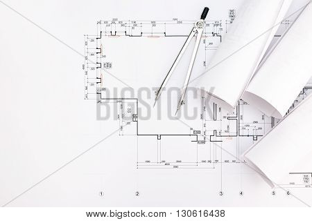 Architect Workspace With Blueprints And Drawing Compass