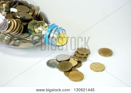 Thai baht coins falling from recycle bottle on white background