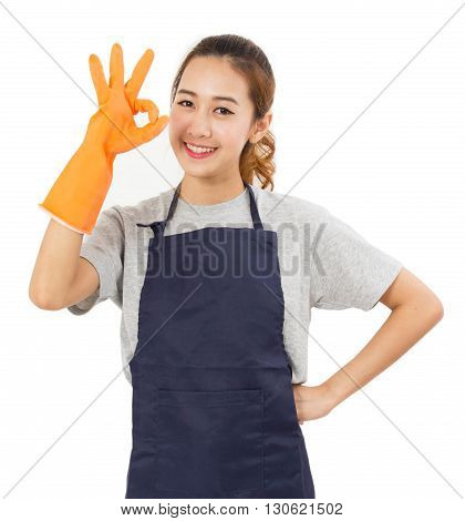 Smiling Asian Woman Wearing Rubber Gloves On a White Background.