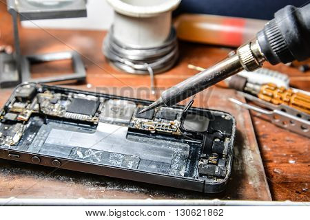 Repairing a mobile phone with soldering iron