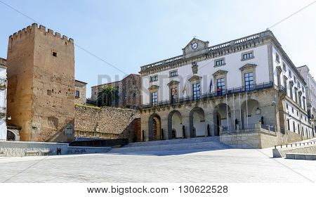 City Hall and the Tower of the grass in the Plaza Mayor in Caceres Extremadura Spain
