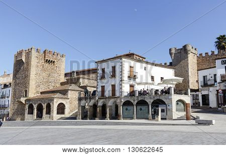 Caceres Spain - March 16 2016: Square of Caceres Bujaco Tower Chapel of Peace and bow of the Star in the Plaza Mayor.