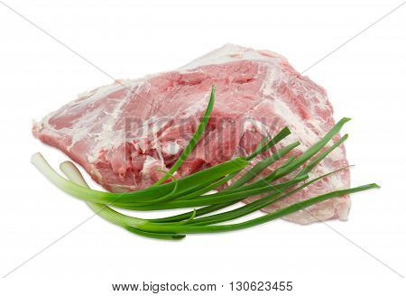 Big piece of fresh uncooked pork from the cut of hind leg and two green onion on light background