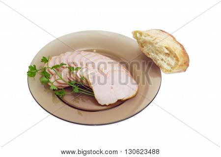 Sliced pork loin and sprig of parsley on a dark glass dish and piece of a pita on a light background
