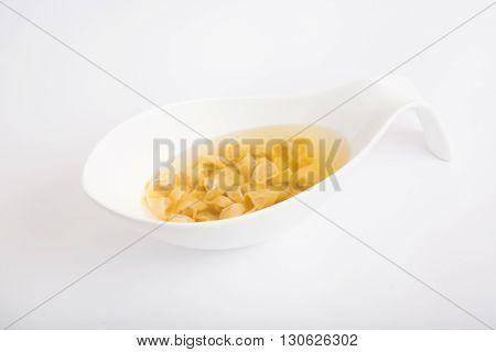 Yellow italian macaroni soup on a white background