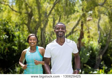 Happy couple running together at park