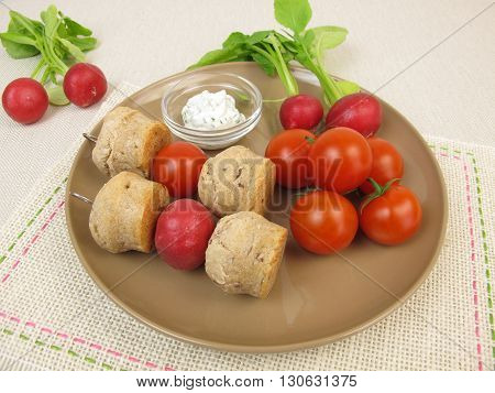 Small party rolls skewers and cherry tomatoes, red radishes, carrots and dipping sauce